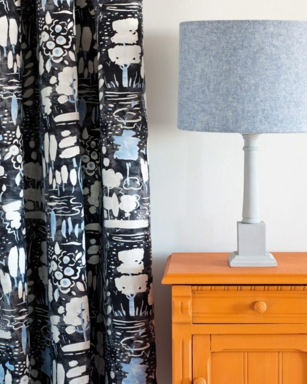 Barcelona-Orange-side-table-Dulcet-in-Graphite-curtain-Linen-Union-in-Old-Violet-Old-White-lampshade