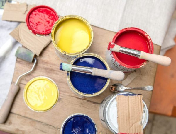 Stencil-Brushes-by-Annie-Sloan-resting-on-Chalk-Paint-tins-in-English-Yellow-Emperors-Silk-and-Napoleonic-Blue